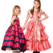 Little girls in a long dress — Stock Photo