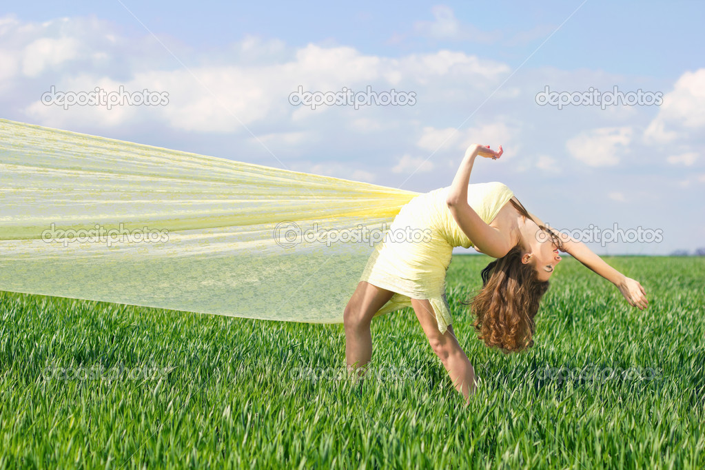 Expressive young woman in a green field — Stock Photo #10670234