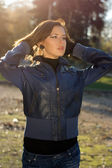 Charming girl in autumn park — Stock Photo