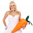 Sexy young blonde with a carrot — Stock Photo