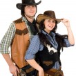 Royalty-Free Stock Photo: Young cowboy and cowgirl. Isolated