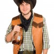 Young cowboy with a bottle — Stock Photo