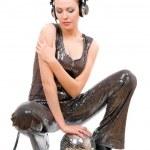 Nice young brunette in headphones — Stock Photo