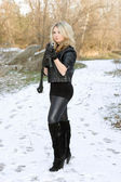Attractive young blonde with a gun — Stock Photo