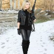 Pretty young woman with a gun — Stock Photo