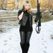 Sexy young woman with a gun — Stock Photo #9229718