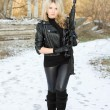 Young pretty woman with a gun — Stock Photo