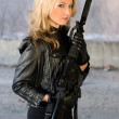 Pretty woman holding a gun — Stock Photo