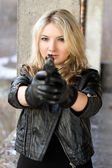 Brave young woman aiming — Stock Photo