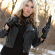 Stock Photo: Serious armed womin winter