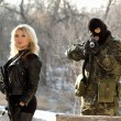 Soldier and blonde armed with rifles — Stock Photo