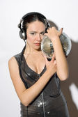 Portrait of sensual young woman in headphones — Stock Photo