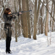 Armed woman in the forest — Stock Photo #9444162