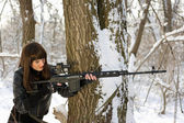 Beautiful woman with a sniper rifle — Stock Photo