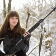 Armed young lady with a gun — Stock Photo #9681954