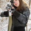 Brunette aiming a gun — Stock Photo