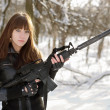 Beautiful armed girl in the forest — Stock Photo #9681963