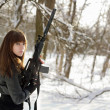 Armed woman in the winter forest — Stock Photo #9681965