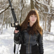 Brunette with the raised rifle — Stock Photo