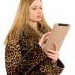 Blonde looking at the tablet pc — Stock Photo #9681974