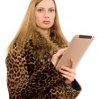 Blonde keeps the tablet pc — Stock Photo