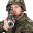 Stock Photo: Armed soldier aiming m16