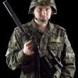 Stock Photo: Armed soldier grasping m16
