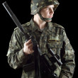 Stock Photo: Soldier grasping gun
