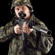 Stock Photo: Alerted soldier keeping gun