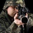 Alerted soldier pointing m16 in studio — Stock Photo