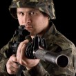Watchful soldier aiming m16 in studio — Stockfoto #9786275