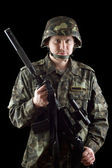 Armed soldier grasping m16 — Stockfoto