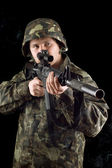 Alerted soldier keeping a gun — Stock Photo