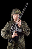 Alerted soldier raised m16 in studio — Stock Photo