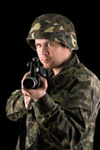 Watchful soldier with m16 — Stockfoto