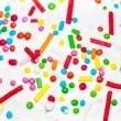 Small candies on sugar glaze — Stock Photo