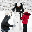 Children build the snowman — Stock Photo