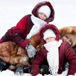 Family cheerfully play to snow — Stock Photo