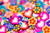 Background gentle flowers, petals and hearts — Stock Photo