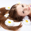 Close-up of young womwith white flowers — Stock Photo #8987420