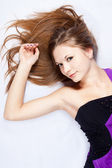 Beautiful harmonous young woman with long hair — Stock Photo
