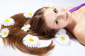 Close-up of a young woman with white flowers — Stock Photo