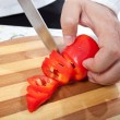 Royalty-Free Stock Photo: Cook hand with knife cutting vegetable