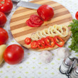 Table with vagatables in kitchen — Stock Photo