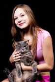 Girl the teenager holds on hands of the big gray cat — Stock Photo