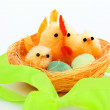 Easter chickens and hen in a nest — Stock Photo #9707300