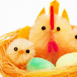 Easter chickens and hen in a nest — Stock Photo #9707623