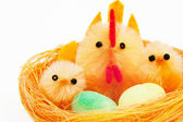 Easter chickens and hen in a nest — Stock Photo