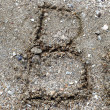 Stock Photo: Collection of handwritten English alphabet in the sand exotic b