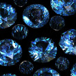 Set of round blue sapphire isolated on black backgroun - Stock Photo